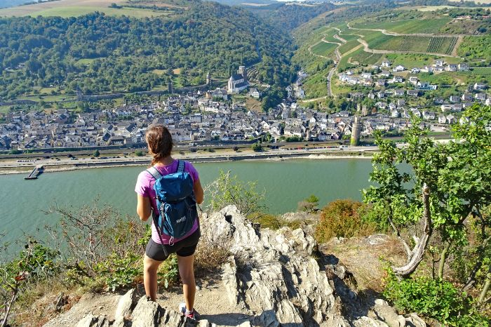 Hiker with view onto the rhine river