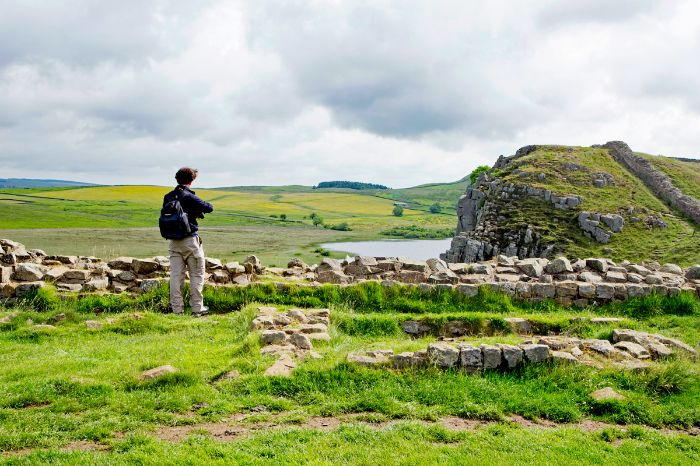 Hiker with beautiful view on the Hadrians Wall