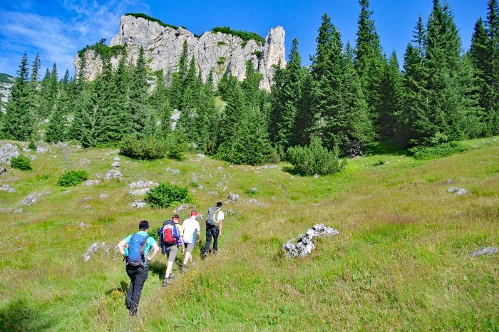 Group of hikers on a high-altitude trail in Durmitor mountains