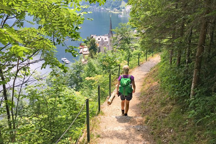 Hiker at the Soleleitungs-path towards Hallstatt
