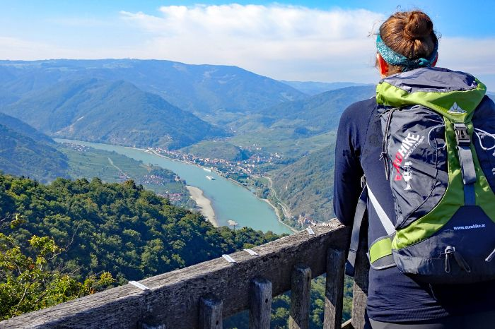 Hiker at the view point Seekopf with view onto Danube