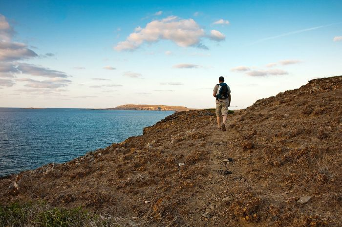 Hiker at costal paths in Menorca