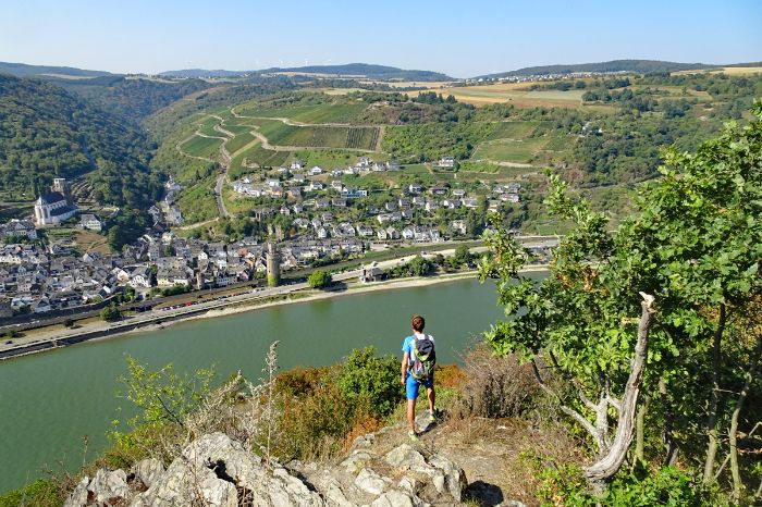 Hiker with view onto the river Rhine