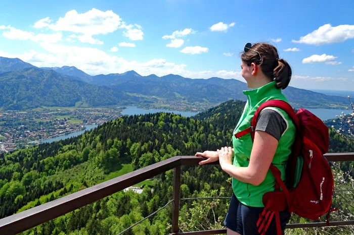 Hiker on Mountain Riederstein with view to lake Tegernsee