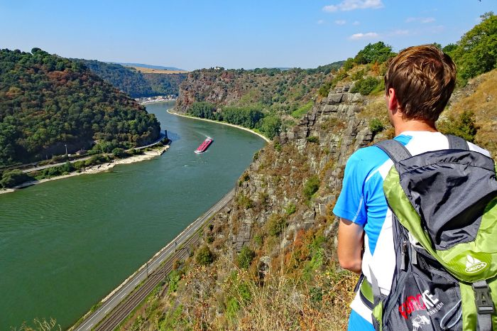 Hiker with view to the Loreley rock on the rhine river