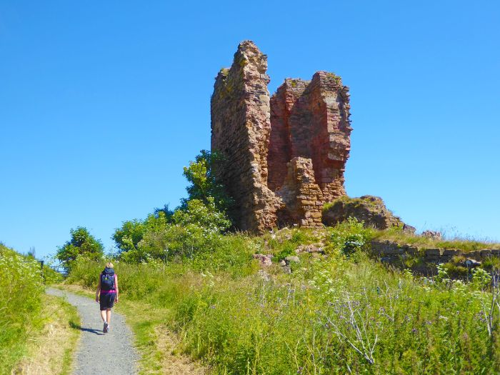 Historic ruin with hiker on the Fife Coastal Path