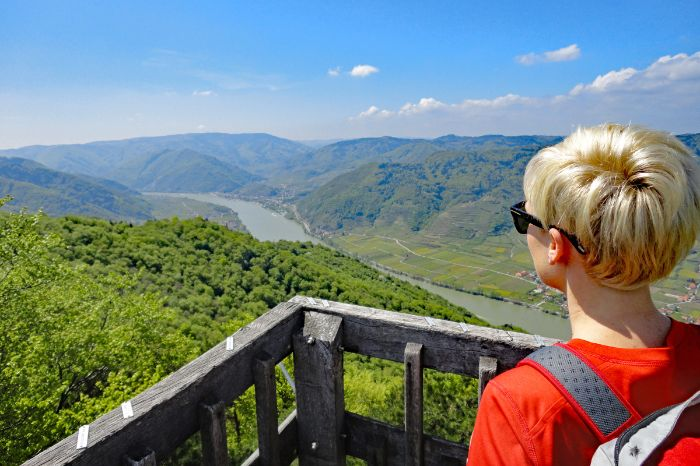 Hiker with view onto blue Danube