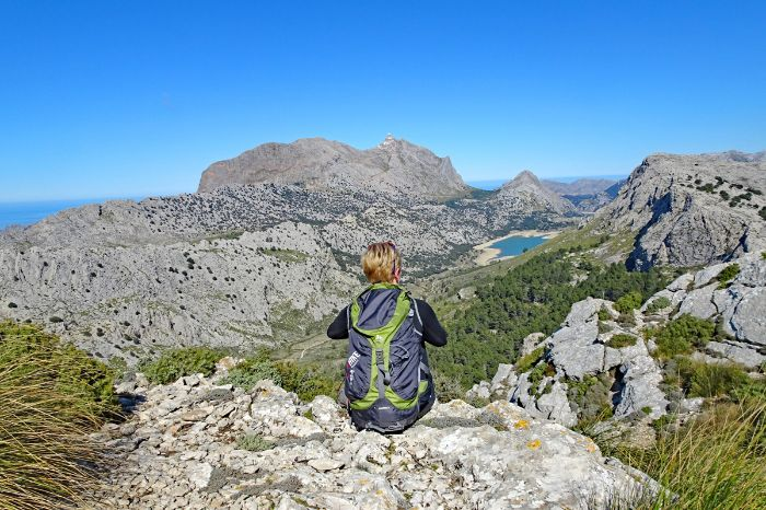 Iking break with panoramic views of the mountain Puig de l'Ofre